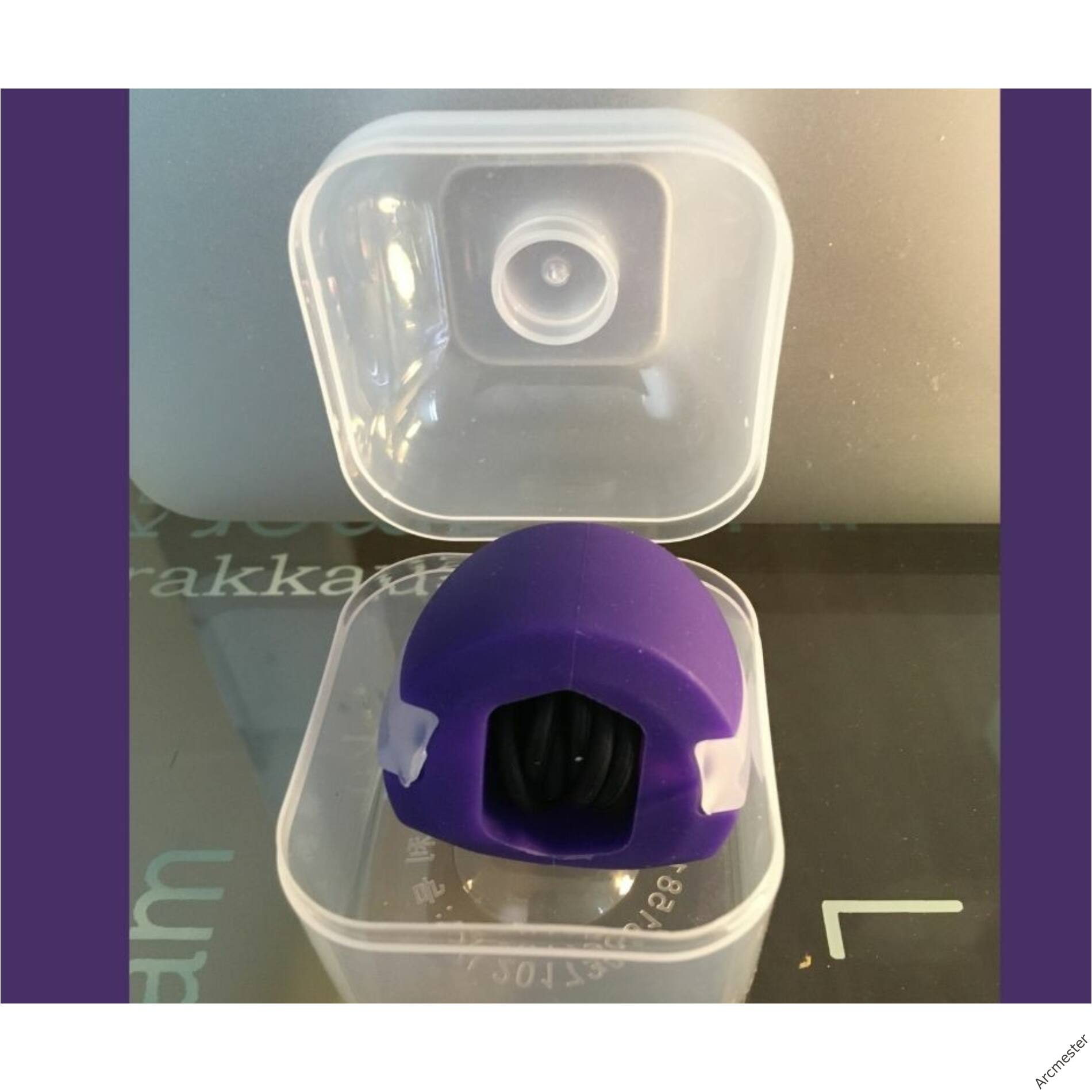 Arcizomedző labda lila + műanyag doboz